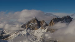 Sasso Lungo peak covered in clouds winter time lapse Stock Footage