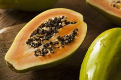 Raw organic green papaya Stock Photos