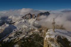 Cross on top of Sella peak Sasso Lungo  in clouds, Campitello ski resort 6K Stock Footage