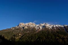 Stock Video Footage of Dolomite Alps, mountain ridge, snow blown over summit, high winds 6K