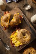 hearty breakfast sandwich on a bagel - stock photo