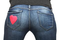 girl's bum with heart-shaped post-it on her jeans pocket - stock photo