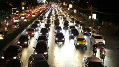 Bangkok traffic headlights flowing on Rama IV road timelapse - stock footage