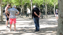 BOULES IN ST TROPEZ PARK Stock Footage