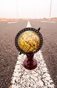 Globe earth on an asphalt street Stock Photos