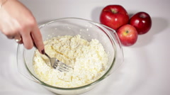 Mixing cottage cheese for baking cheesecacke Stock Footage