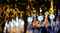 star bokeh, christmas light in nighttime - stock footage
