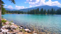 4K Crystal Clear Lake, Sun and Mountains, Jasper Park, Alberta Canada - stock footage
