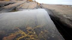 Rocky bath in  sea after low tide Stock Footage