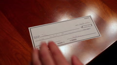 Stamping paid on check Stock Footage