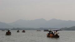 Pleasure boat on west lake Stock Footage