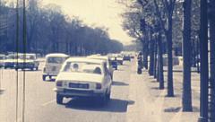 Paris 1975: traffic in Champs-Élysées Stock Footage