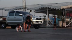 Asian family, mother with two children walking on the pier, playing, having fun. Stock Footage