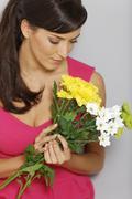 woman flower arranging - stock photo