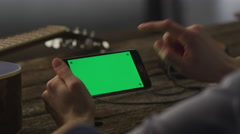 Musician Using Phone in Landscape Mode at Home Stock Footage