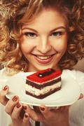 Beautiful smiling young woman with a cake Stock Photos