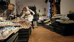 LADY IN CHRISTMAS DECORATED EGG SHOP SALZBURG AUSTRIA Stock Footage