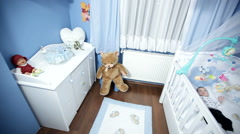 Babys room, baby nursery, babys bedroom.baby is lying in his crib - dynamic shot Stock Footage