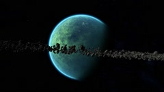 Green planet surrounded by asteroid ring 01 Stock Footage