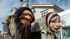 Iceland city of Akureyri 030 male and female troll in a downtown street Stock Footage