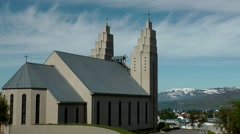 Iceland city of Akureyri 018 landmark church in beautiful nature backdrop Stock Footage