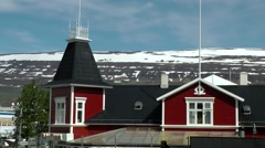 Iceland city of Akureyri 016 snowy mountain behind colonial style building Stock Footage