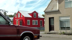 Iceland city of Akureyri 009 small cityscape with part of a car and two houses Stock Footage