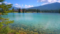 4K Glittering Transparent Lake Water, Turquoise Reflection, Alberta Canada Stock Footage