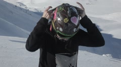 cool ski girl put on her goggle - stock footage