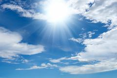 bright sun and clouds - stock photo