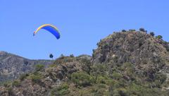 Two paragliders in flight above the mountain Stock Footage