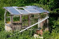 old derelict shed in an allotment - stock photo
