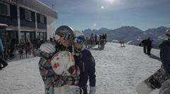 Snowboard girls having fun posing for photo Stock Footage