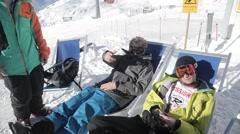 Cool sunbath on skies top of mountain ralax having fun shooting a camera Stock Footage