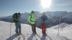Freeriders skiers on skies talking where to go Stock Footage