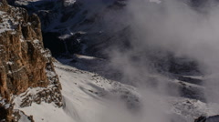 Mountain road in Pordoi Pass winter clouds rolling in 4K Stock Footage