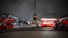Street traffic at Trafalgar Square by night - stock footage