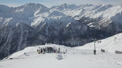 Ski group waiting on the hill Stock Footage