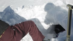 Avalanche lesson in hole under snow Stock Footage