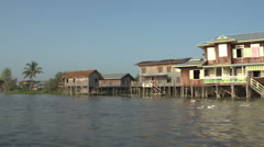 Nyaung Shwe, Cruising waterway with houses on stilts - stock footage