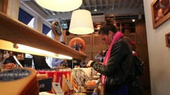Woman sample Dutch cheese inside a store in Amsterdam Stock Footage
