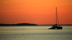 Sailing boat at sunset Stock Footage