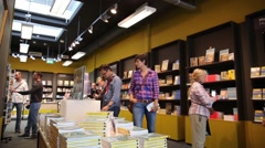 Customers inside a book store in Europe Stock Footage