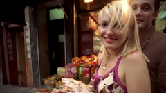 Couple hugging, kissing and shopping for food in outdoor market in Chinatown NYC Stock Footage