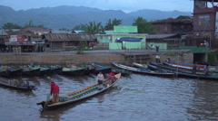 Nyaung Shwe, longboats floating in the harbour Stock Footage