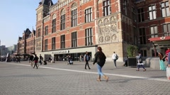 People walking in front of Amsterdam central train station Stock Footage