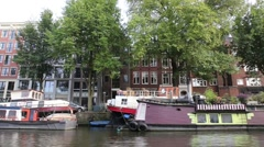 House boats on the canals of Amsterdam Stock Footage