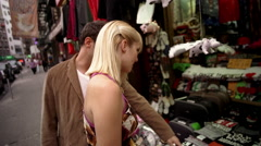 Couple shopping in outdoor market in Chinatown NYC Stock Footage