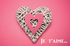 Composite image of wicker heart ornament with paper cut out - stock illustration