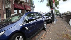Electric car charging station in Amsterdam, Netherlands Stock Footage